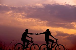 Couple cycling sunset